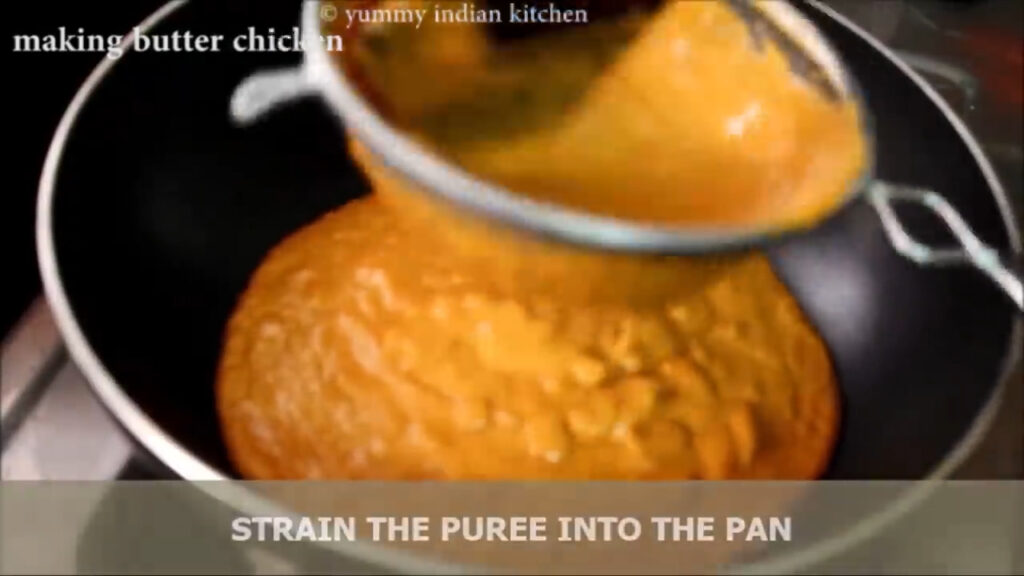 Straining the blended puree into the pan with the help of a strainer