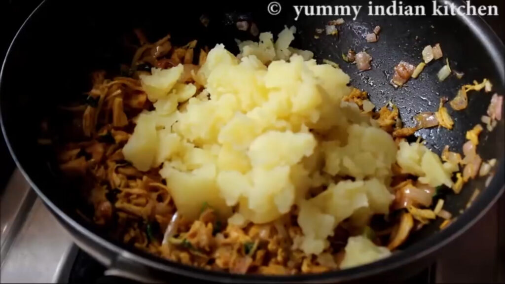 adding boiled and mashed potatoes