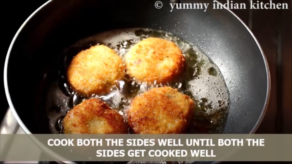frying the chicken cutlets on both sides