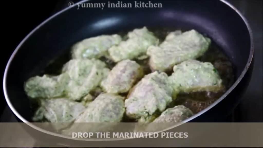 Adding the marinated chicken malai tikka pieces