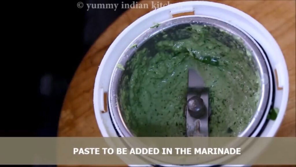 making paste of herbs and cashew nuts