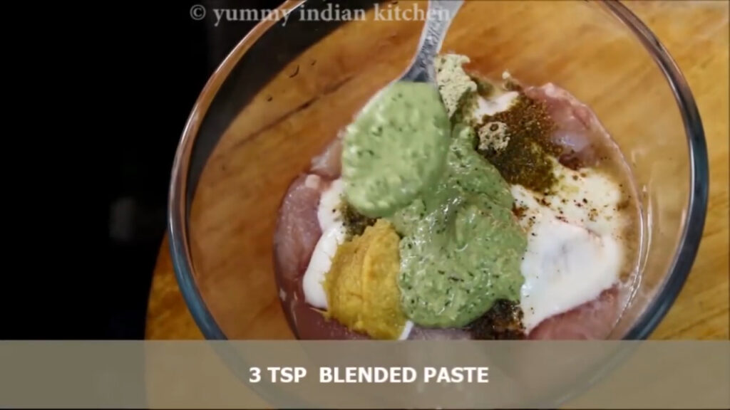 adding the paste into the chicken