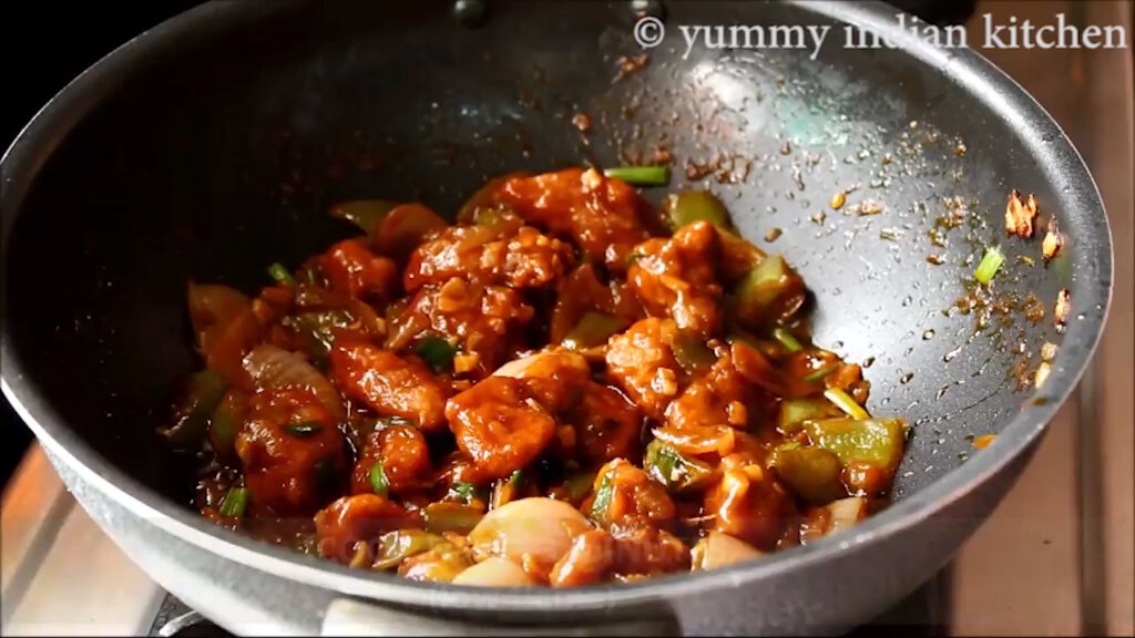 sauteing for few minutes and serving the chicken manchurian