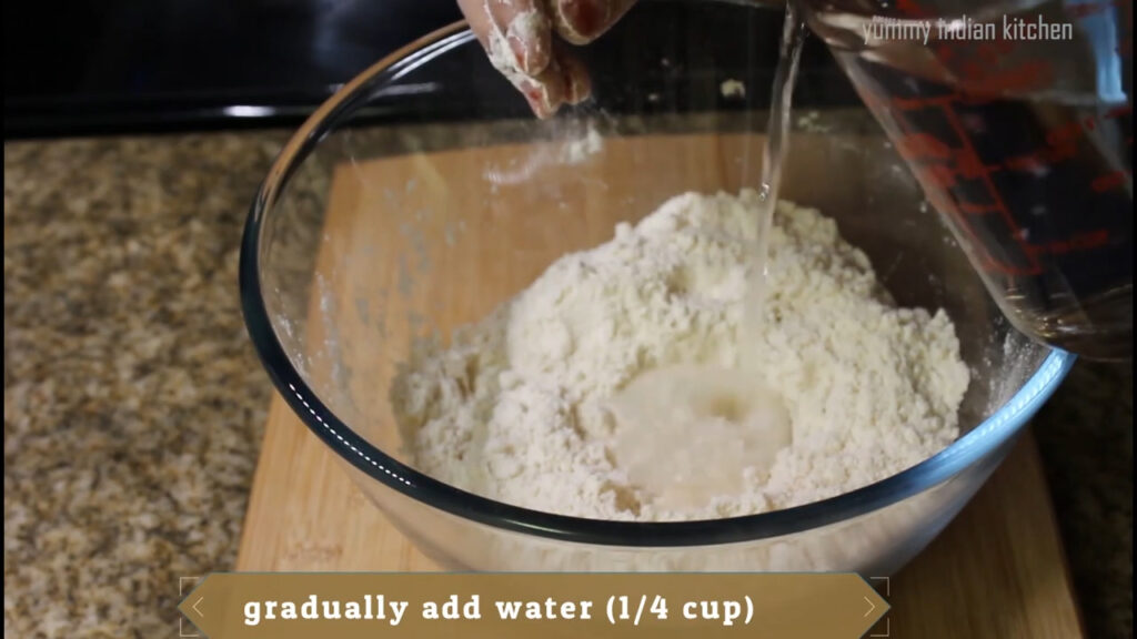Adding water gradually and kneading the dough