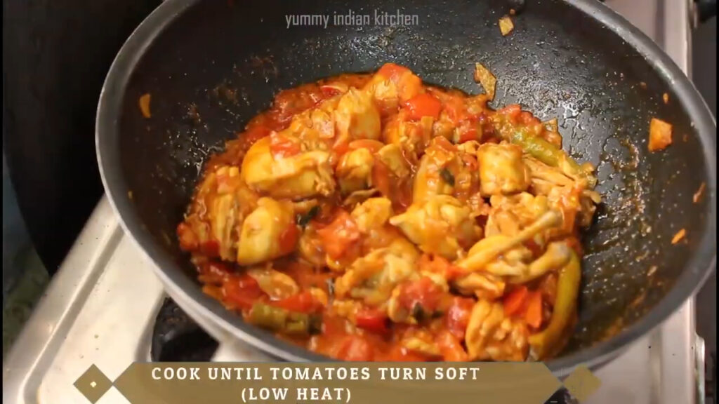 Adding 2 chopped tomatoes and cooking