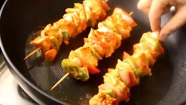 cooking the chicken tikka sticks