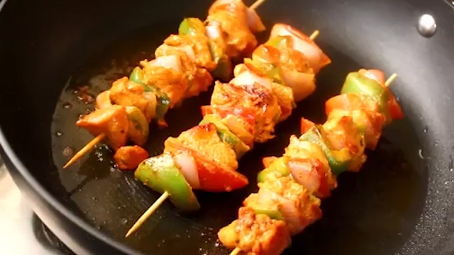 turning and cooking chicken tikka well