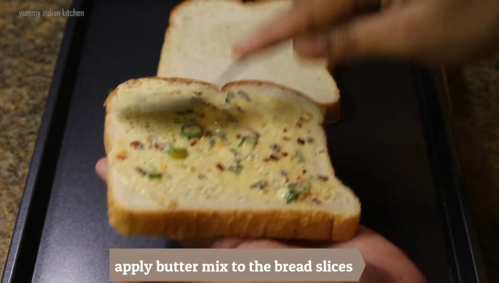 applying this butter mix to one side of the bread