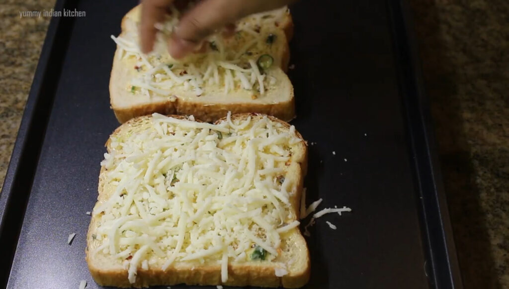 Using grated mozzarella cheese and spreading it all over the bread slices