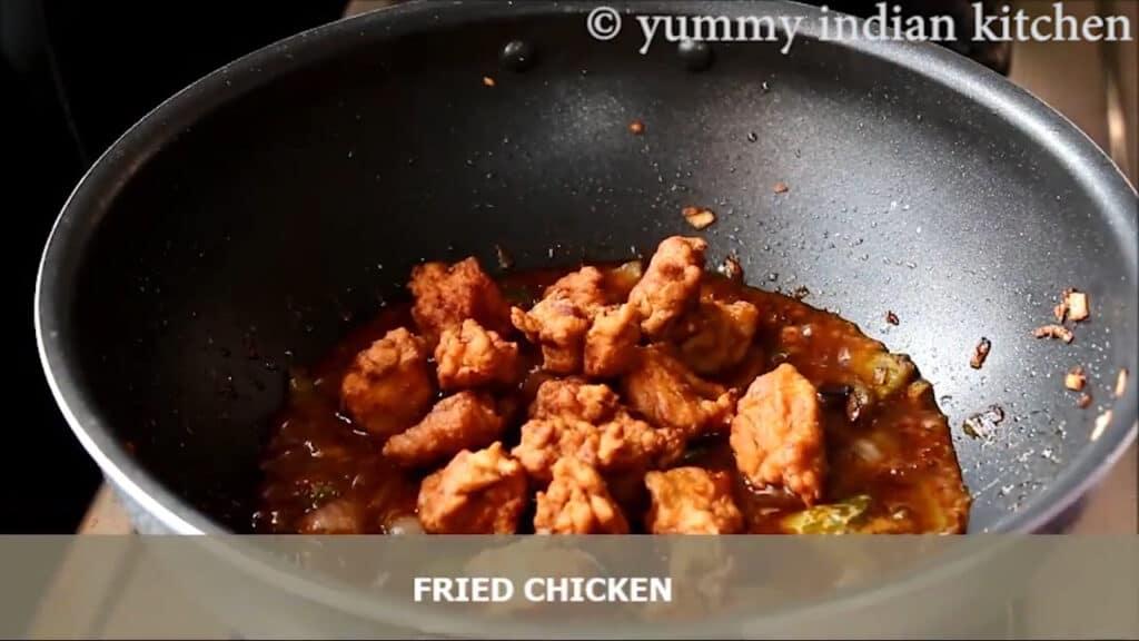 Adding fried chicken pieces