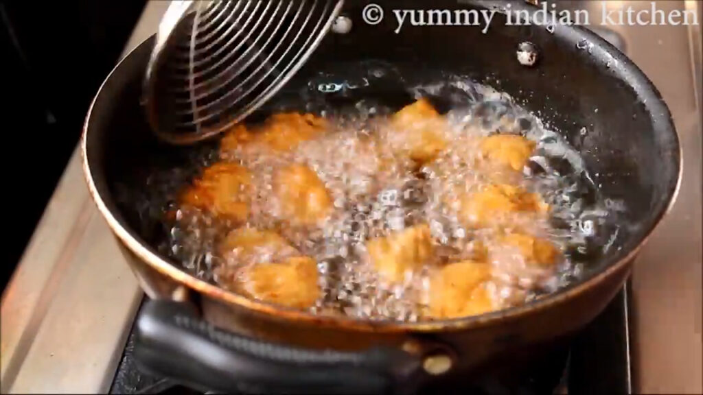 deep frying the chicken pieces
