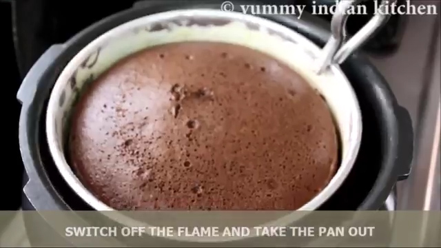 Remove the cake pan from the cooker
