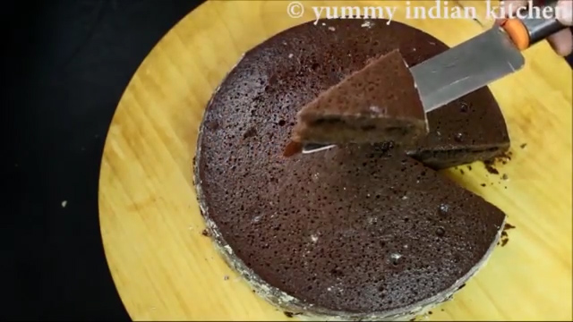 cutting and serving hot the chocolate cake in cooker