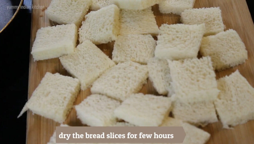 Cutting out the corners of the bread and make cubes