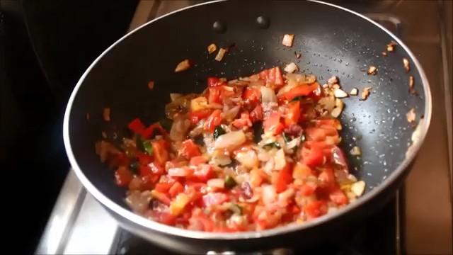 adding finely chopped tomato