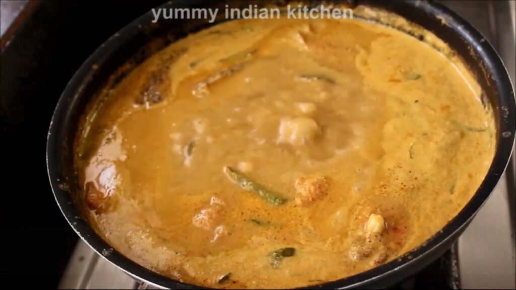 cooking the fish curry