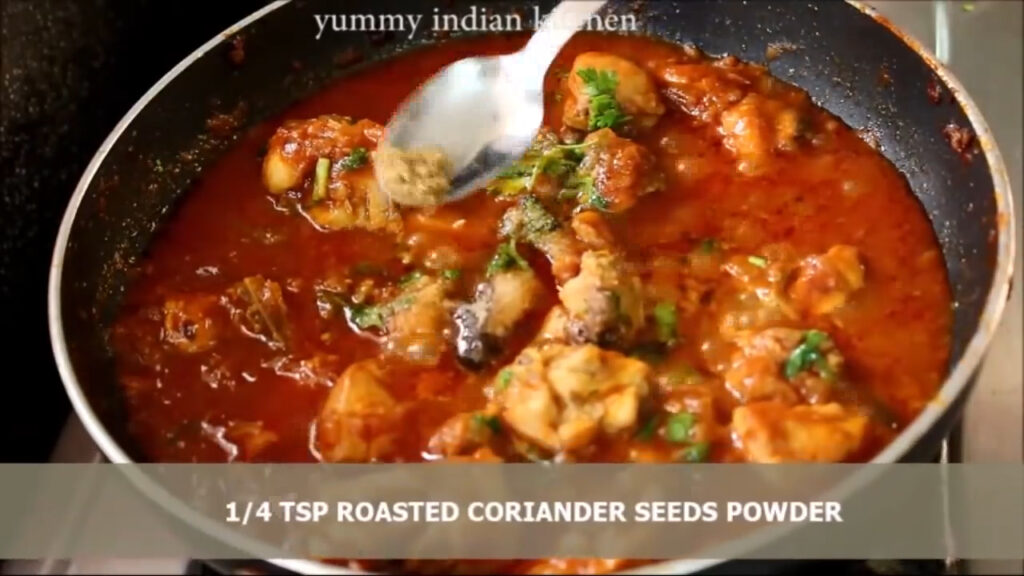 adding black peppercorn powder to indian chicken curry