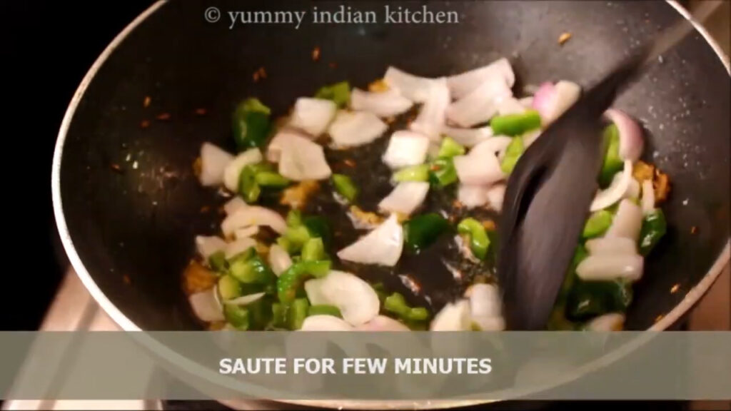 Sauteing the onions and green capsicum