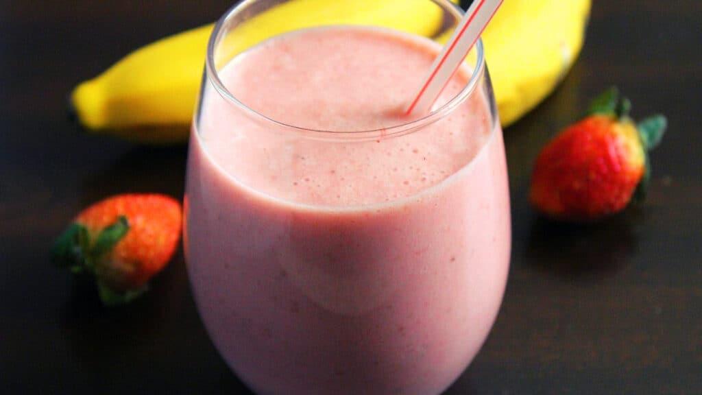 serving the Strawberry Banana Smoothie with yogurt