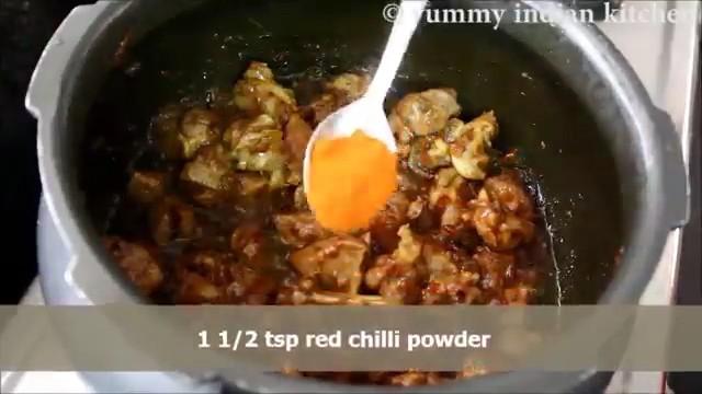Adding red chilli powder