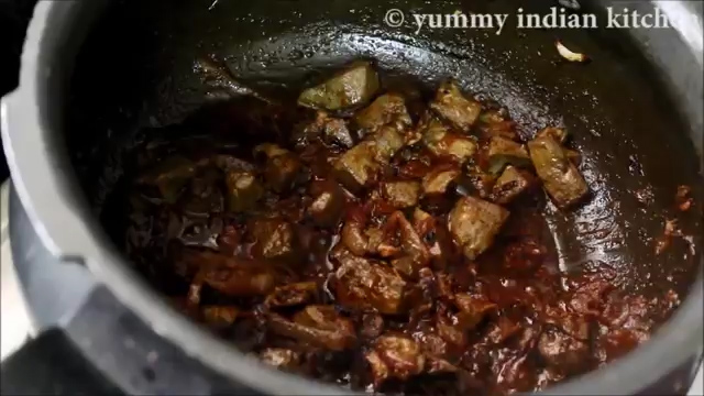Cooking the masala gravy until oil starts leaving