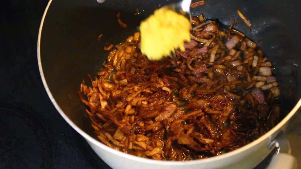 Adding ginger-garlic paste
