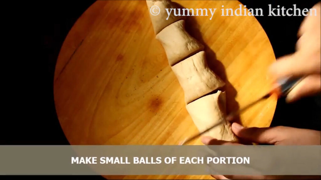 Dividing the dough into small lemon sized equal portions