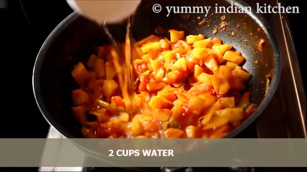 Adding water to the potato curry