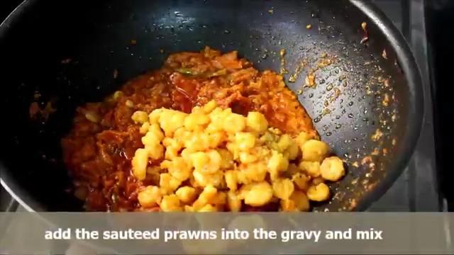 Adding the sauteed prawns