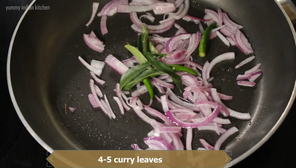 Adding slit green chillies, curry leaves and sauteing the onions