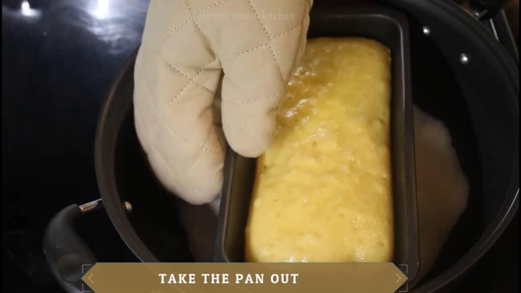Taking the vanilla sponge cake pan out