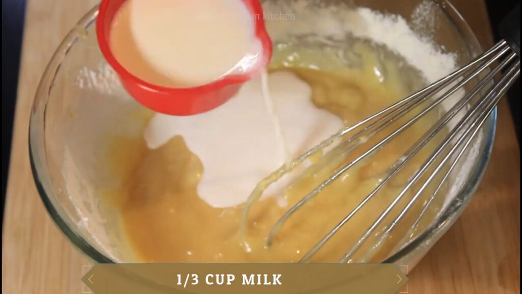 adding milk little by little and mixing the batter without any lumps
