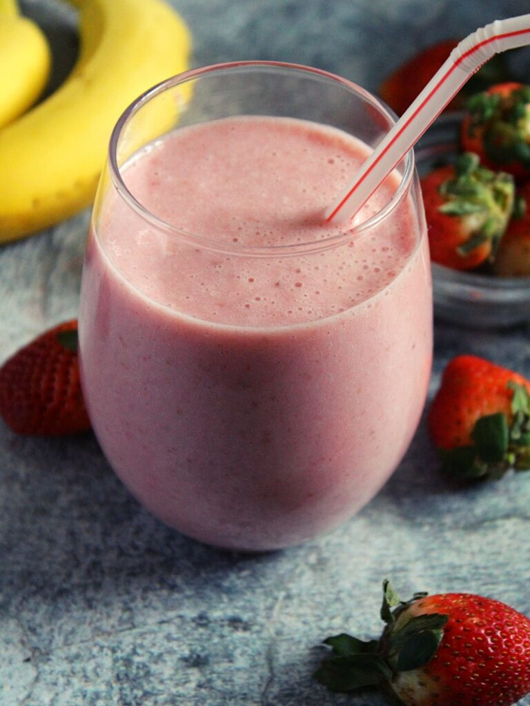 Mcdonald's Strawberry Banana Smoothie served in glass with a straw
