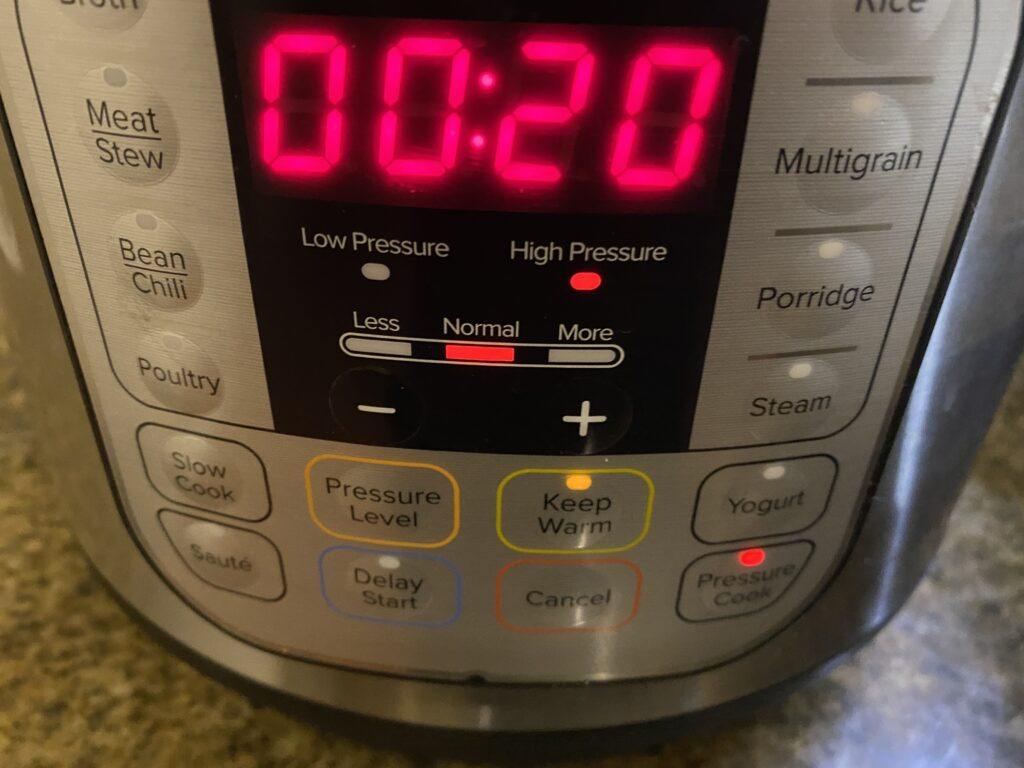 Setting the timer to pressure cook for 20 minutes