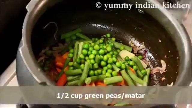 adding veggies to the masala