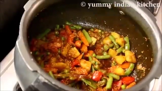 Mixing and cooking until the masala is cooked well