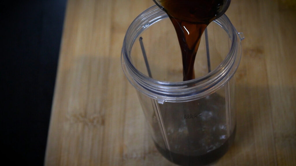 adding a cup of brewed coffee