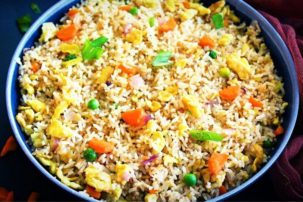 serving the hibachi fried rice or Japanese fried rice