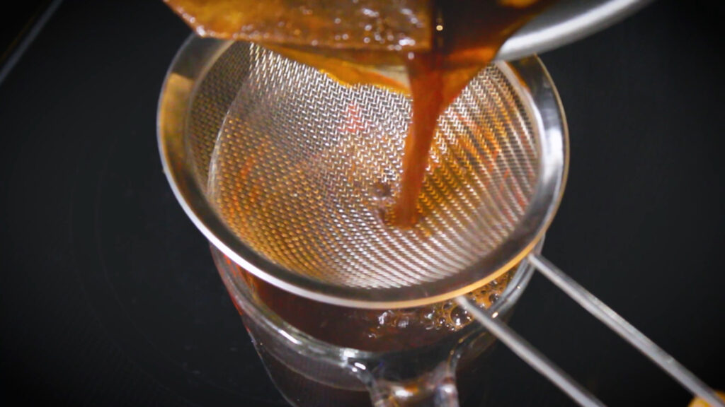 straining the chai concentrate